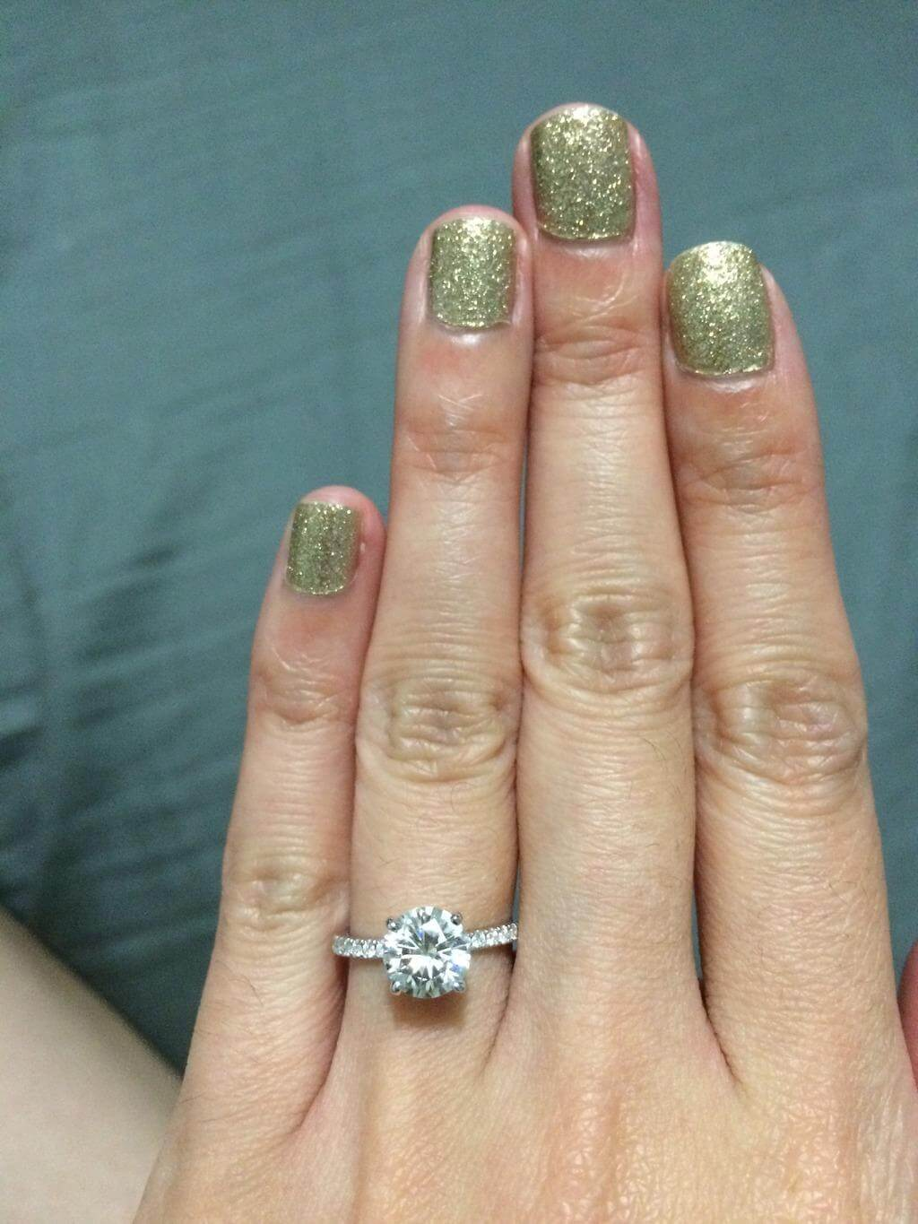 1 carat round diamond on a small hand with size 2.5 ring finger